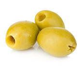 Three green olives isolated on white background.