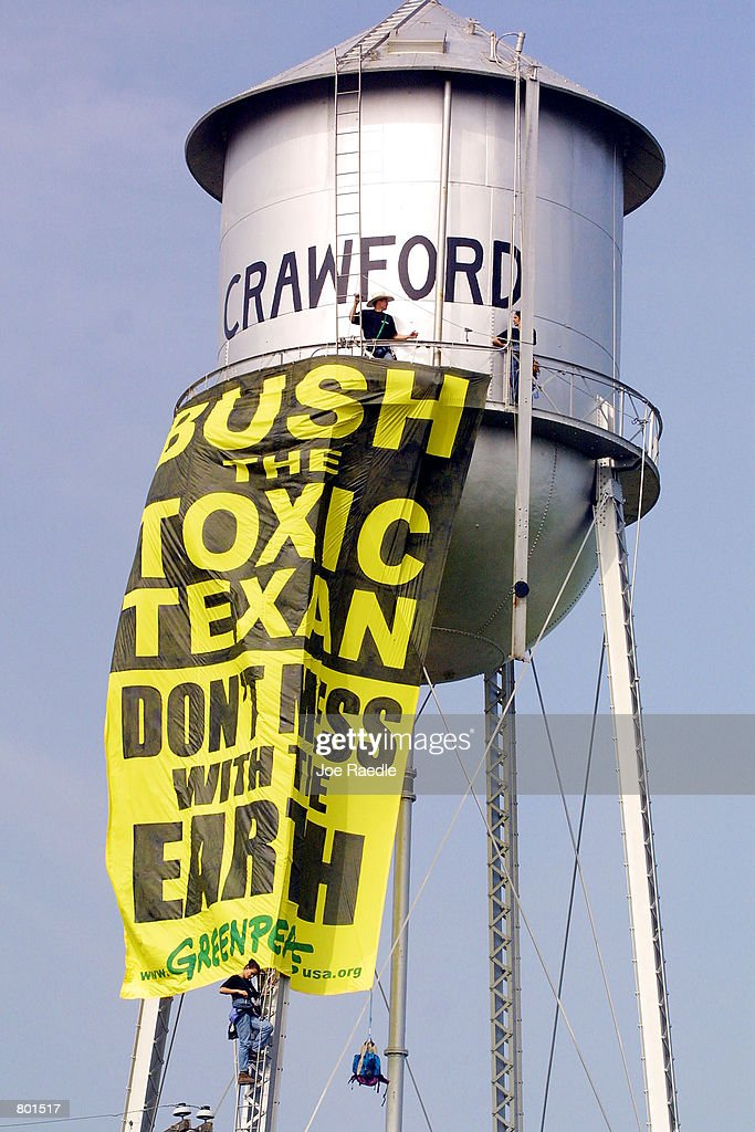 Three Greenpeace activists climbed the water tower in Crawford Texas April 132001 and hung a 30 foot tall banner with a message for President Bush...