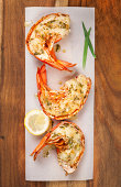 Top view of grilled lobster tails with lemon tarragon butter