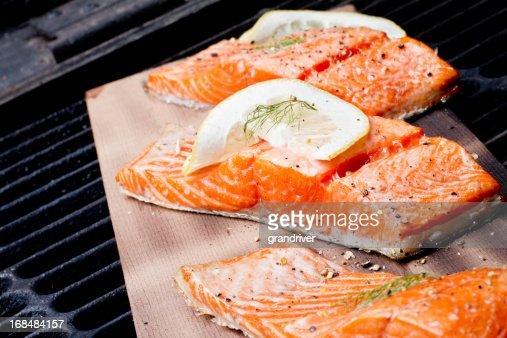 Three Grilled Salmon Filets on Cedar Plank