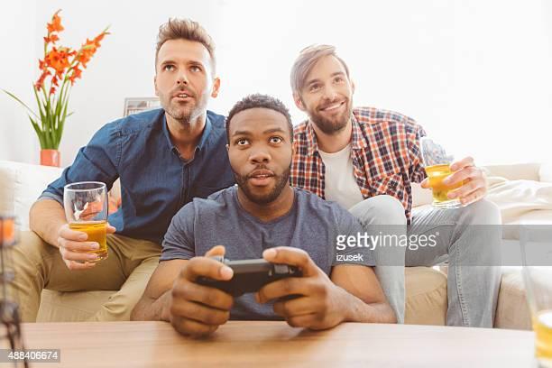 Three guys playing video games