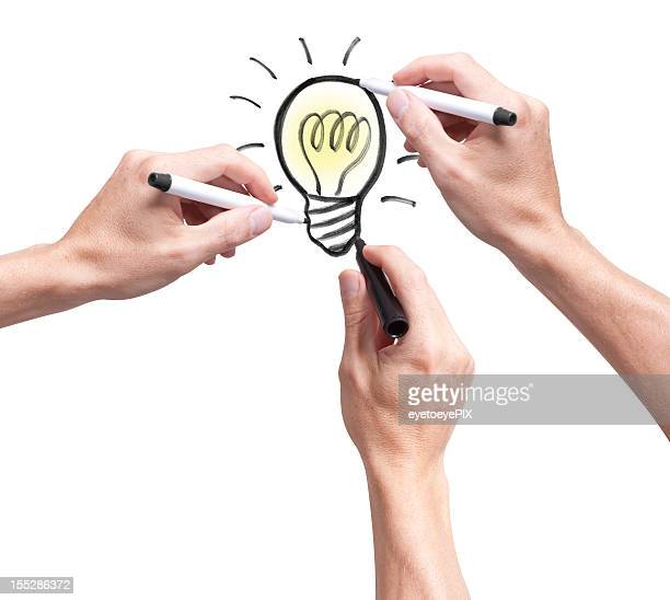 Three hands in a brainstorming session