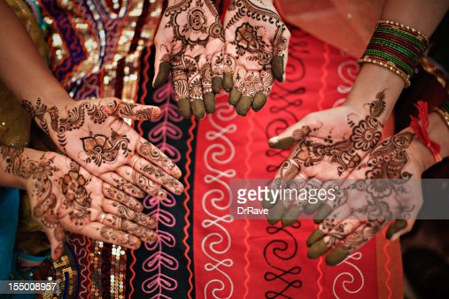 Three hands with henna : Stock Photo