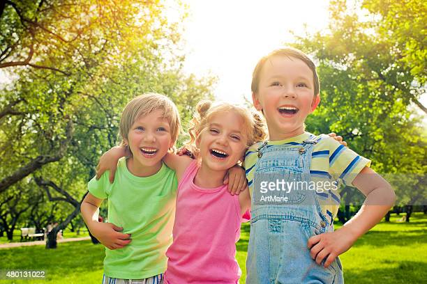 Three happy children in summer