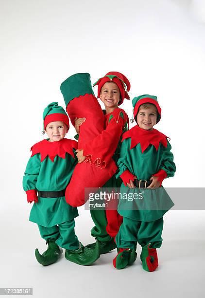 three happy elves with stocking