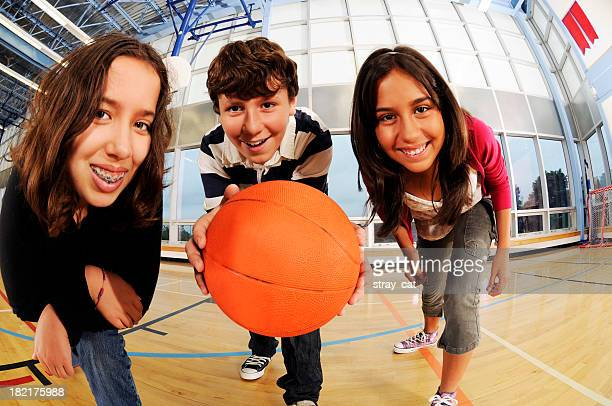 Three Happy Kids with a Basketball