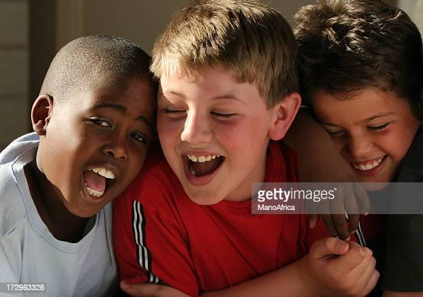 Three happy schoolboy friends