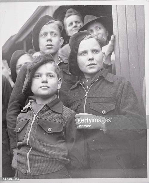 Three healthy looking German schoolboys listen to welcome speech on their arrival at Grunewald Station in the British sector of Berlin They were...