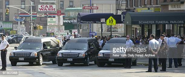 Three hearses await their coffins outside St Michael's Church in Brooklyn during the funeral of family killed by a car driven by an allegedlydrunk...