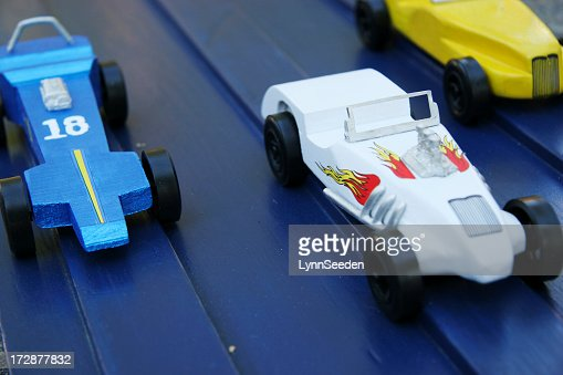 Three Homemade Wooden Toy Race Cars On A Wooden Track Stock Photo