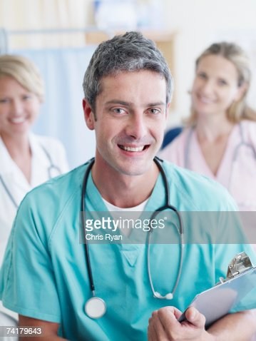 Three hospital workers smiling : Stock Photo