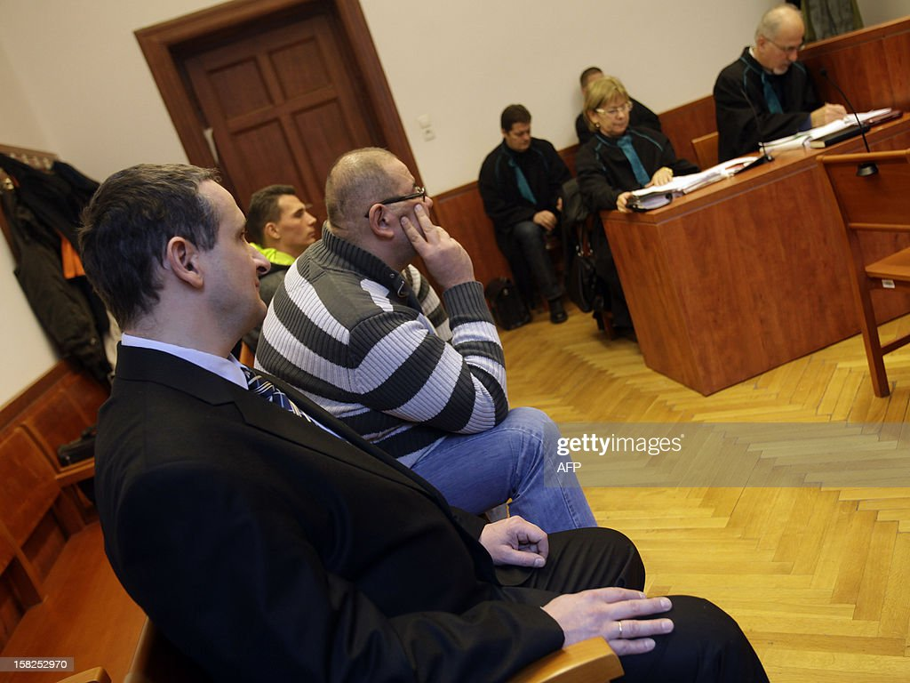 Three Hungarian men charged with stealing the dead body of late German billionaire Friedrich Karl Flick in 2008 and demanding a ransom attend the trial at the Pest Central District Court in Budapest on December 12, 2012. The men are alleged to have stolen Flick's coffin in November 2008 from his mausoleum at a cemetery in Velden, in southern Austria, after succeeding in shifting aside a 100-kilogramme (220-pound) slab of granite. The suspects demanded a six-million-euro (7.5-million USD) ransom from Flick's family and received two payments of 100,000 euros each, according to Austrian police at the time.