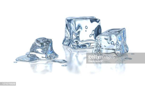 Three ice cubes melting against a white background
