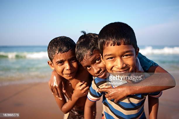 Three Indian boys on the beach