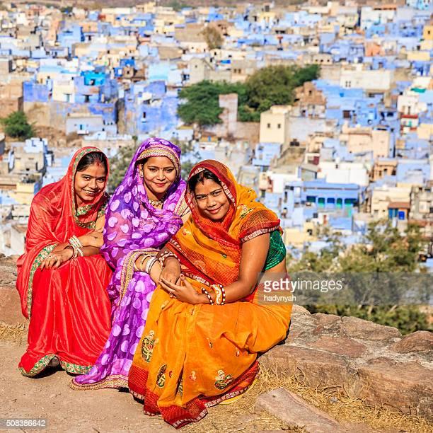 Three Indian women resting in Mehrangarh Fort, Jodhpur, India
