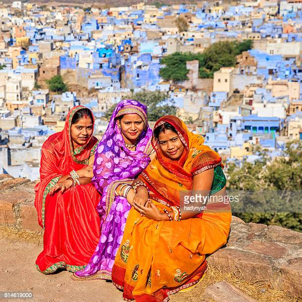 Three Indian women resting in Mehrangarh Fort, Jodhpur, India