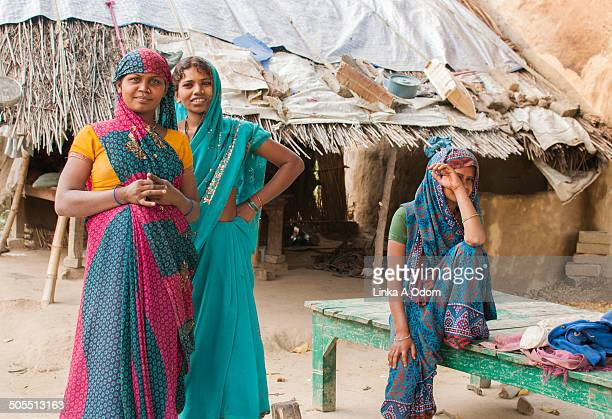 Three Indian young adult females in a village