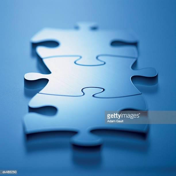Three Interlocking Jigsaw Puzzle Pieces
