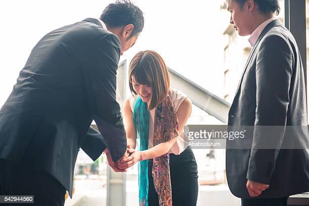 Three Japanese Businesspeople Meeting in Kyoto, Japan