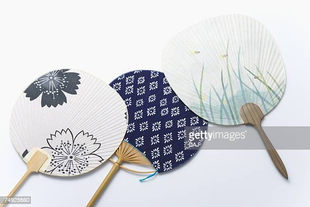 Three Japanese fans, high angle view, white background