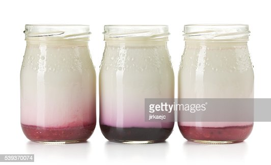 three jars with fruity yogurt : Stock Photo