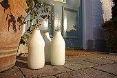 Landscape image of three pints of milk on a doorstep