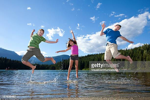 three kids jumping.