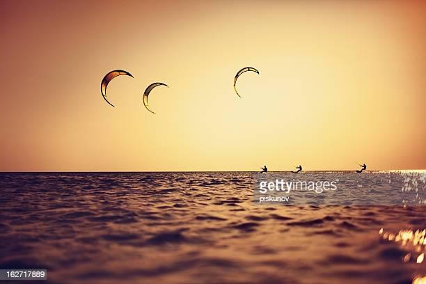 Three Kitesurfers at Sunset