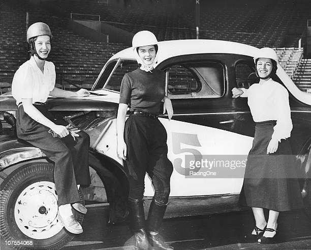 Three lady racers pose with a Modified stock car circa the late1940s