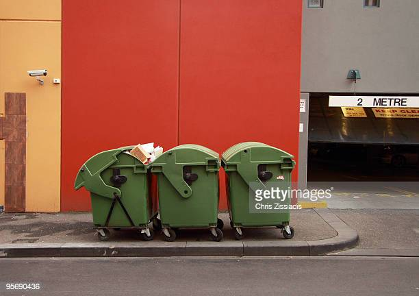 Three large bins awaiting collection