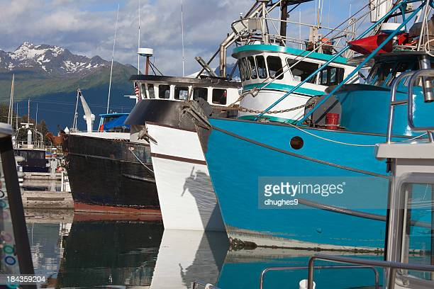 Three large fishing boats anchored in Valdez Harbor