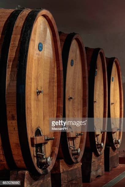 Three large oak casks in a wine cellar