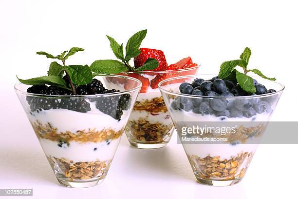 Three layered breakfast fruit berry parfaits