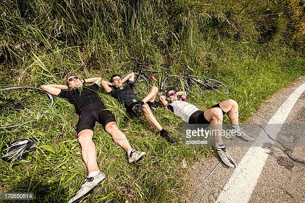 Three Lazy Cyclists Resting on Side of the Road