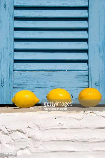 Three lemons in a window