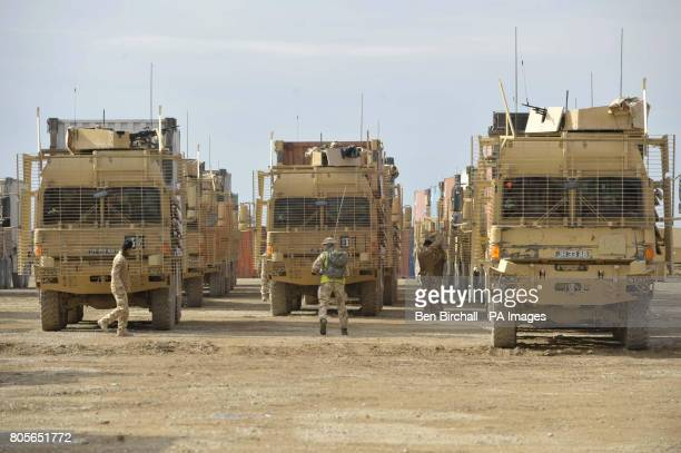 Three lines of armoured Enhanced Palletised Loading System Vehicle that are preparing to carry out a Combat Logistics Patrol alongside the American...