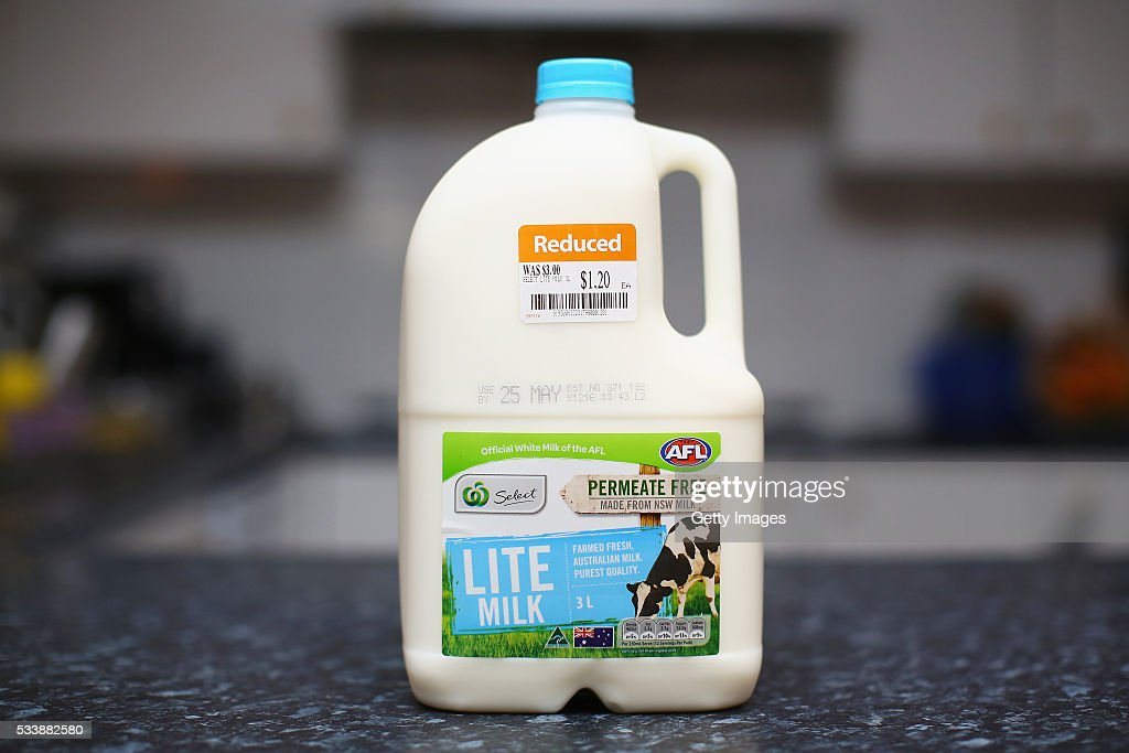 A three litre Woolworths Select branded milk bottle is pictured with a reduced price sticker on May 24, 2016 in Sydney, Australia. Australians are rallying around it's dairy farmers by opting to purchase branded milk rather than the cheaper store brands after the country's largest dairy company Murray Goulburn last month cut the price it pays suppliers by 15%.