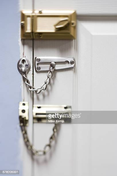 Three locks on door