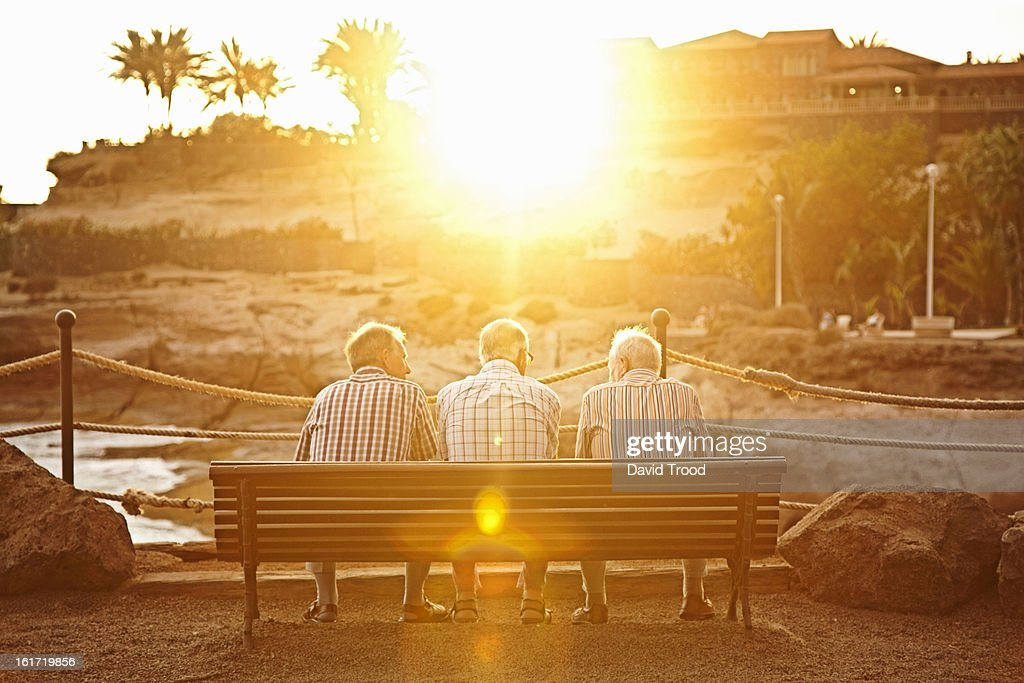 Three male pensioners on a bench : Stock Photo
