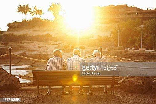 Three male pensioners on a bench : Bildbanksbilder