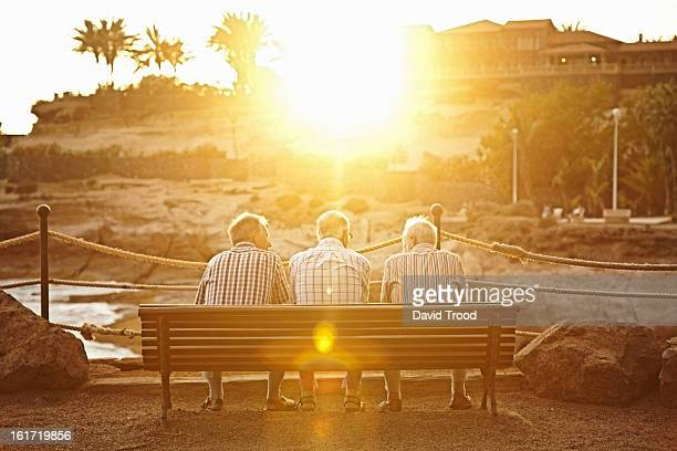 Three male pensioners on a bench