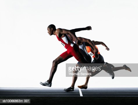 Three male runners crossing finish line : Stock Photo