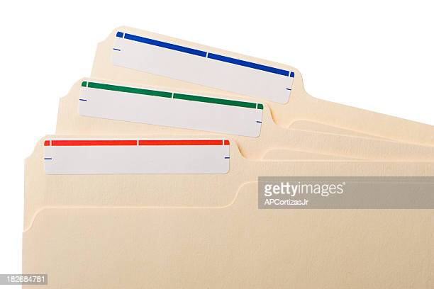 Three manila folders with colored labels