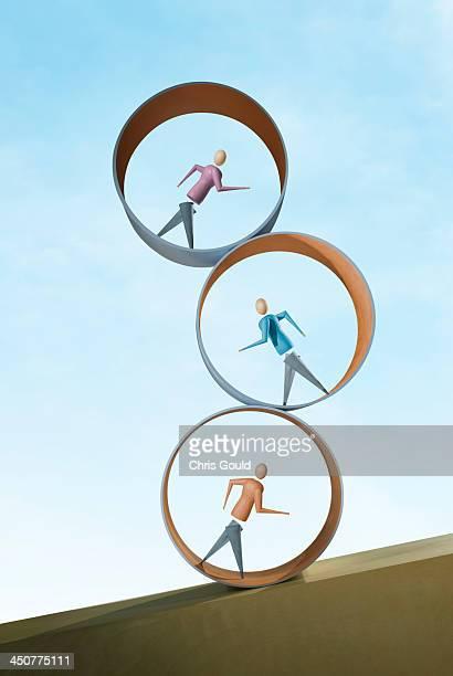 Three mannequin figurines in stacked treadmills