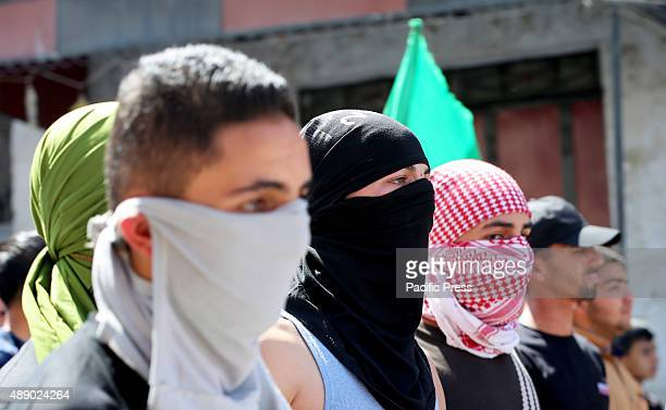 Three masked Palestinian youth take part in a demonstration in the West Bank city of Hebron In the West Bank city of Hebron hundreds of Palestinians...
