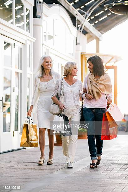 Three mature women shopping