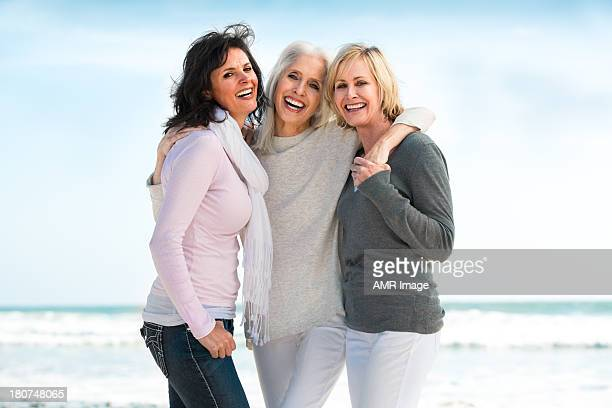Three mature women smiling big