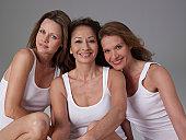 Three mature women, smiling, portrait