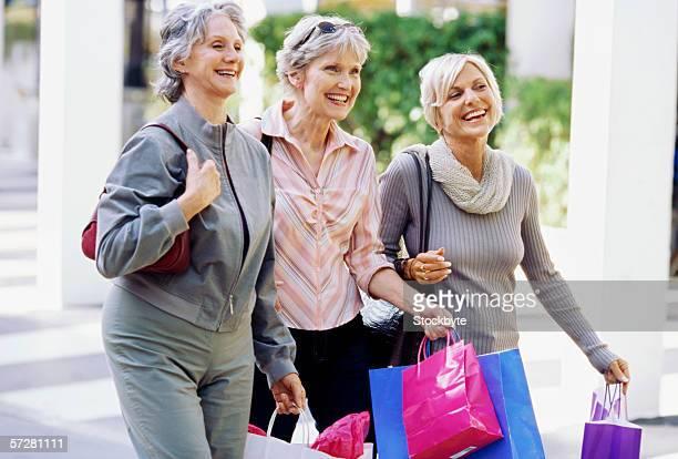 Three mature women walking and talking