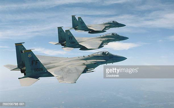 Three McDonnell Douglas F-15 Eagles in flight during training mission